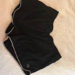 Moving Comfort running shorts